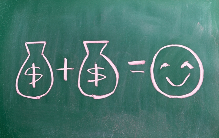 concept of money brings you happiness writen on chalkboard